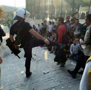 Police Kick at Moria (taken by refugee)